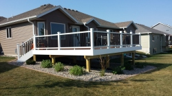 Low maintenance landscape. Deck by TS Custom Decks. Stewartville 2013